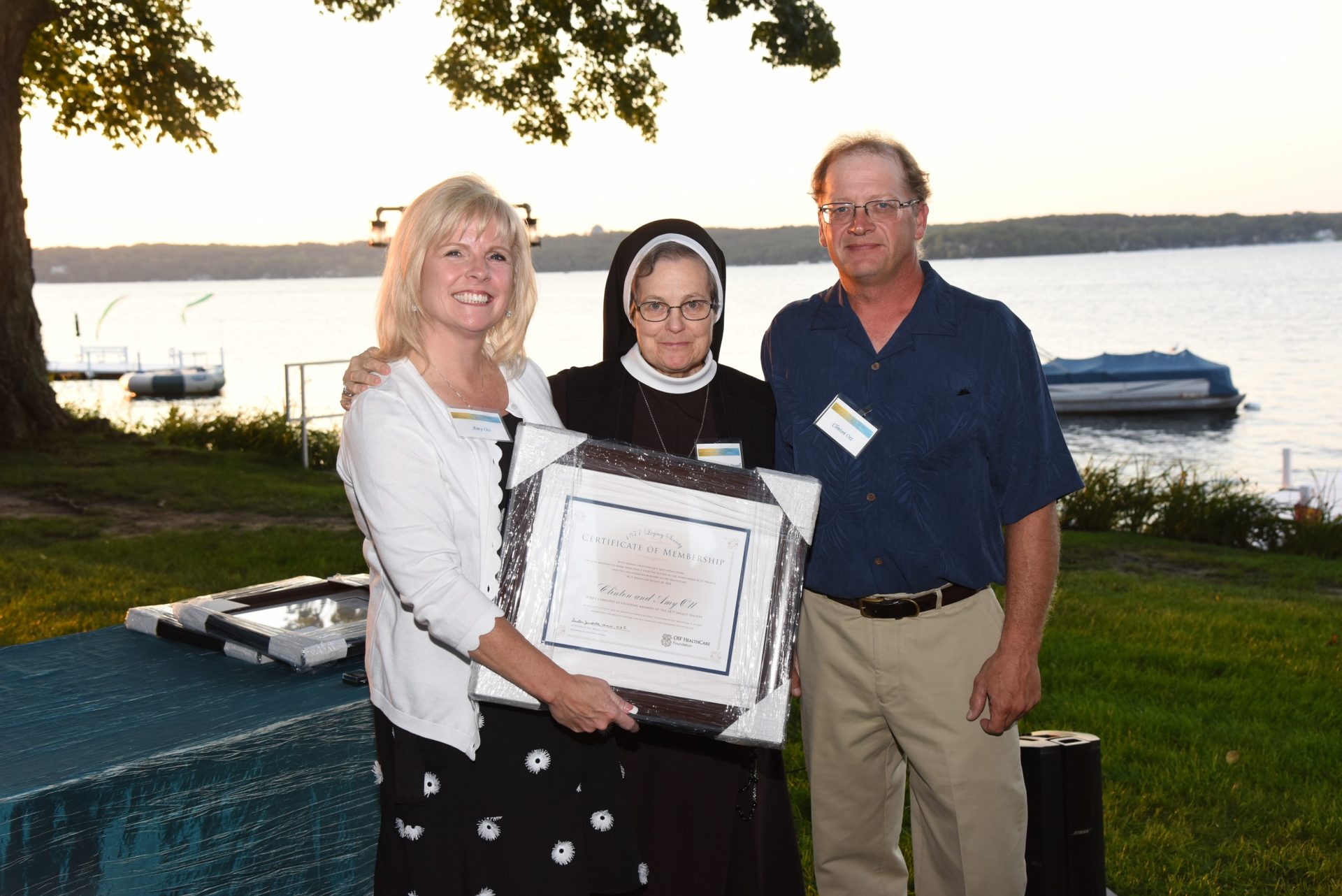 Sister Judith Ann and Recipients of 1877 Legacy Certificate