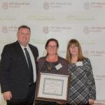 Dr. Kim Johnson, Jean Arvan, and hosptal staff